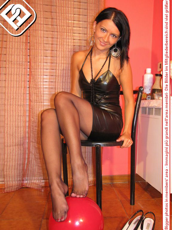 Barbara cute italian pantyhose girl dangling her shoes showing her black nylon clad feet