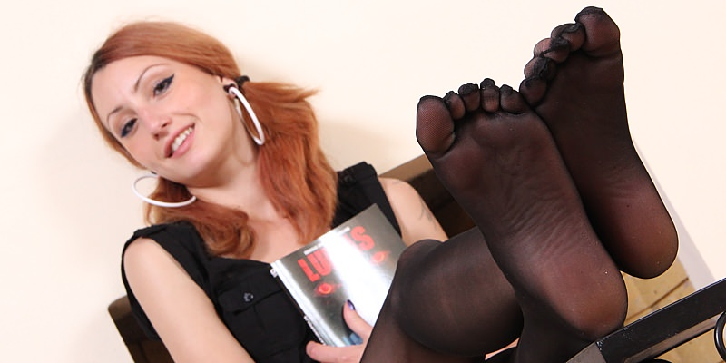 Girl with sexy feet in black pantyhose